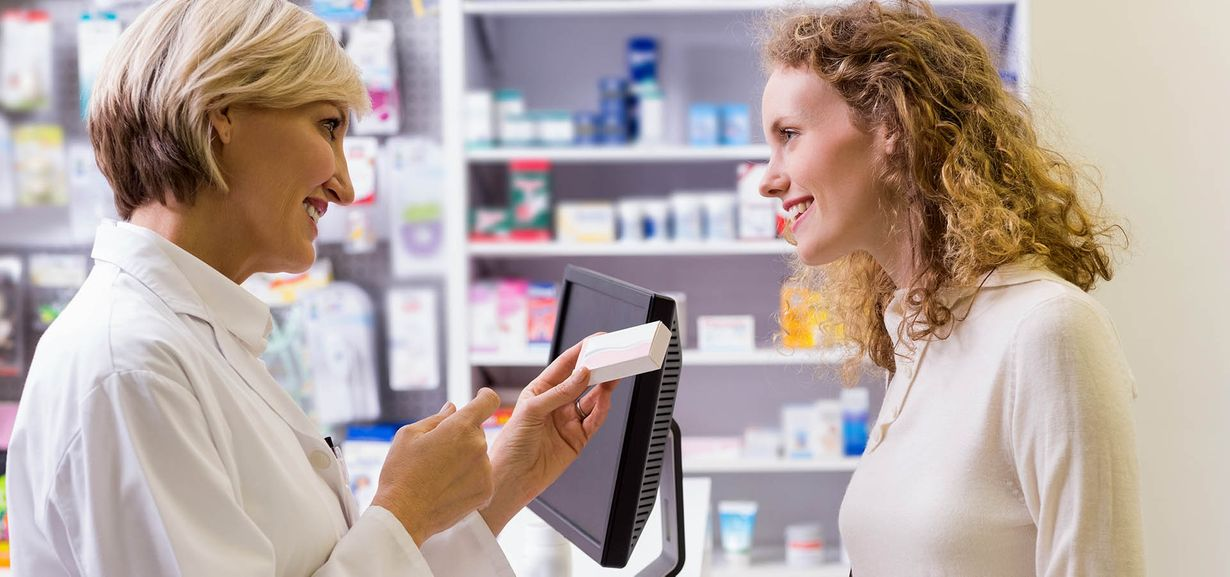 Pharmacist helping customer